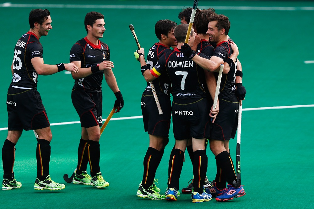 ANTWERPEN, BELGIUM - JULY 03:   Florent Van Aubel (R) of Belgium is congratulated by team mates after he scores a goal uring the Fintro Hockey World League Semi-Final match between India and Belgium held at KHC Dragons Gemeentepark Stadium on July 3, 2015 in Brasschaat, Belgium.  (Photo by Dean Mouhtaropoulos/Getty Images)