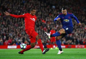 LIVERPOOL, ENGLAND - OCTOBER 17:  Joel Matip of Liverpool closes down Zlatan Ibrahimovic of Manchester United as he shoots during the Premier League match between Liverpool and Manchester United at Anfield on October 17, 2016 in Liverpool, England.  (Photo by Clive Brunskill/Getty Images)